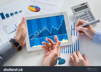 stock-photo-close-up-of-businesspeople-discussing-graph-together-in-office-159748679